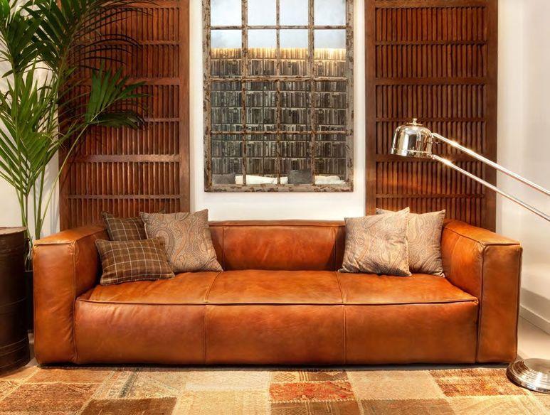 Фото рыжий диван в интерьере